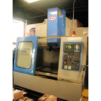 "KIA V35 VERTICAL MACHINING CENTER FANUC OM CNC CONTROL 23.6"" x 17 1/2"" x 26"" TRAVEL 1996"