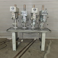 "CLAUSING 15"" FOUR SPINDLE DRILL PRESS ON CAST IRON PRODUCTION TABLE"