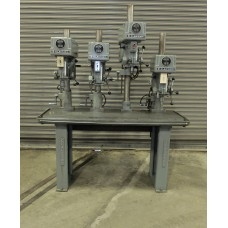 """CLAUSING 15"""" FOUR SPINDLE DRILL PRESS ON CAST IRON PRODUCTION TABLE"""